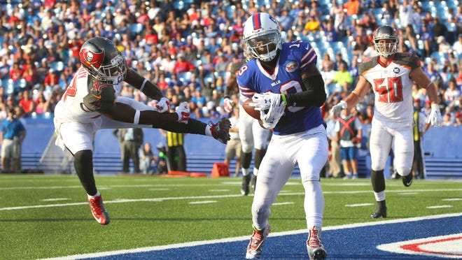 In this file photo, Bills WR Mike Williams scores a touchdown on a pass from EJ Manuel in a 27-14 loss to Tampa Bay.