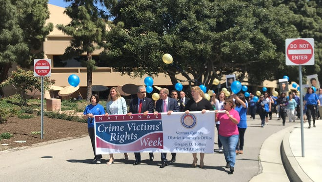 Ventura County elected officials, law enforcement authorities and crime survivors march around the Ventura County Government Center on Wednesday to commemorate National Crime Victims' Rights Week.