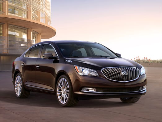 Already a beautiful car with sweep-spear styling, chrome waterfall grille and arching roofline, the 2014 Buick LaCrosse gains a bolder grille, six portholes repositioned to the sides and updated taillamps.
