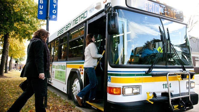 Passengers board a Green Bay Metro bus.