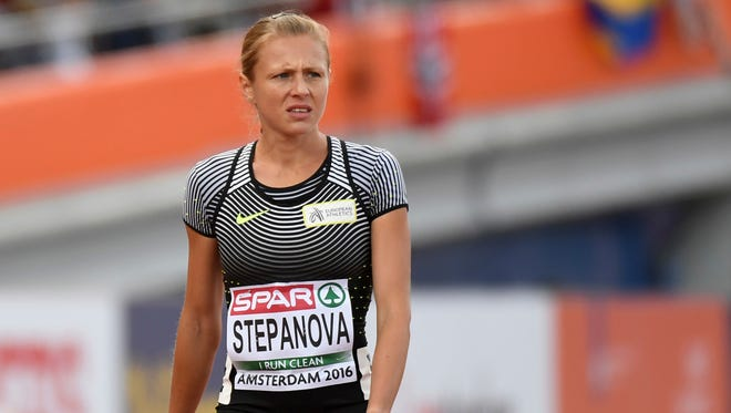 Russian doping whistleblower Yuliya Stepanova  leaves the track after suffering an injury in a women's 800 heat during the European Athletics Championships in Amsterdam.
