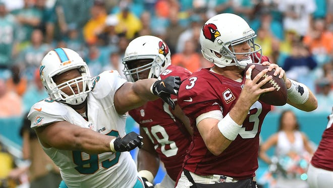Miami Dolphins defensive tackle Ndamukong Suh (93) reaches for Arizona Cardinals quarterback Carson Palmer (3) during the second half at Hard Rock Stadium. The Miami Dolphins defeat the Arizona Cardinals 26-23.