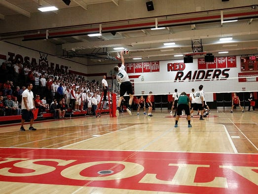 Wauwatosa West's John Frank (3) leaps up to serve against