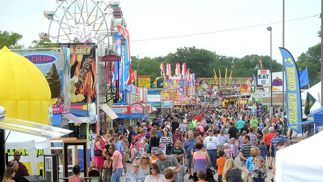 Fairgoers flock to the midway at the 164th Fond du Lac County Fair on Wednesday, at the Fond du Lac County Fairgrounds.