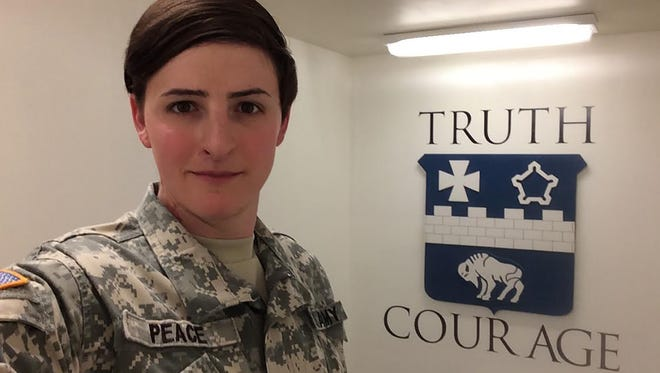 Capt. Jennifer Peace in her military uniform after coming out to her unit about being a transgender female. Peace, who  has been stationed to Fort Huachuca, said she still loves being in the Army despite the struggles.