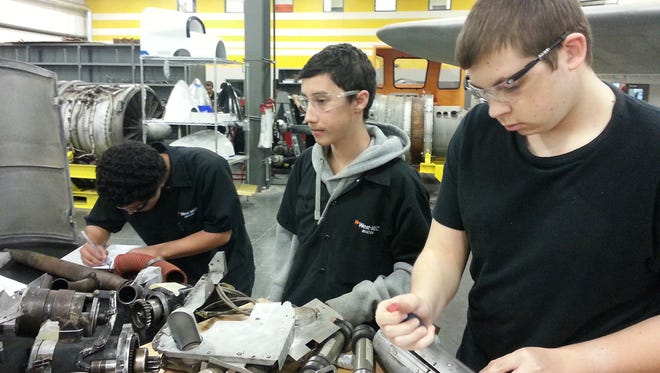 Students work on a project in the aviation program in 2014 at Western Maricopa Education Center (West-MEC), one of the 13 joint technical education districts in Arizona.