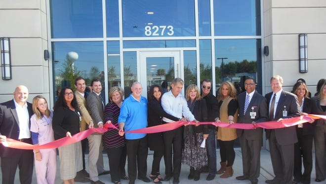 Developer Jim Barnas and local dignitaries attended the Grand Hilton ribbon-cutting ceremony Oct. 7.