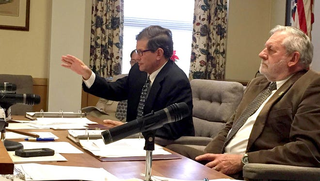 Lebanon County Commissioner Bob Phillips makes a point as Commissioner Bill Ames listens during Thursday's vote on the 2016 county budget.