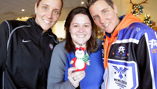 From left, Beth Strauss, Ann Sommerfeldt and Brooke Strauss, all of Fond du Lac, were the winners in the Lost Little Reindeer Contest. They found the reindeer after only two clues from The Reporter staff.