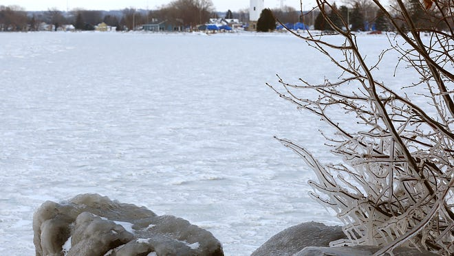 A layer of thin, bumpy ice covers Lake Winnebago along Lakeside Park. The ice is too thin to support ice-fishing shanties.