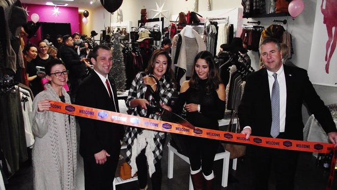 Beyond Trends recently opened in downtown Somerville, Pictured from left to right are Downtown Somerville Alliance Executive Director Beth Anne Macdonald, Somerville Councilman Jason Kraska, Beyond Trends owner Lupe Spisso, store manager Valeria and Somerville Mayor Brian Gallagher.