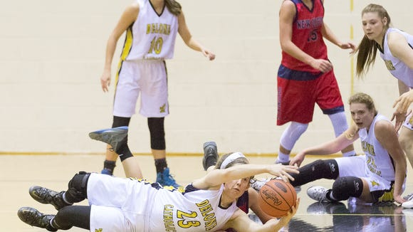 Delone's Ally Shipley reaches for the ball during a