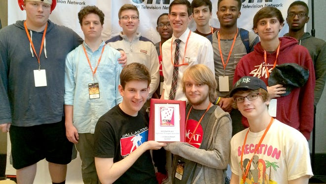 Members of the winning Sitcom team gather for a photo after receiving their award for second place in the Crazy 8 contest at the Student Television Networks National Convention in Atlanta, Ga. Nathan Simms, left, John Easterday, center, and Seth Murphy, right, are pictured in the front row. Pictured in the back row, from left, are: Garrett Kerr, Lucas Staub, Matt Neuheimer, Jalen Walker, Joey Wagner, Reed Mauro, Kyren Smith, Lincoln Bowser, and Marquis Thomas.