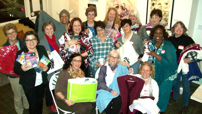 York Women Making a Difference display some of the items they collected for Bell Socialization Services and Dress for Success.