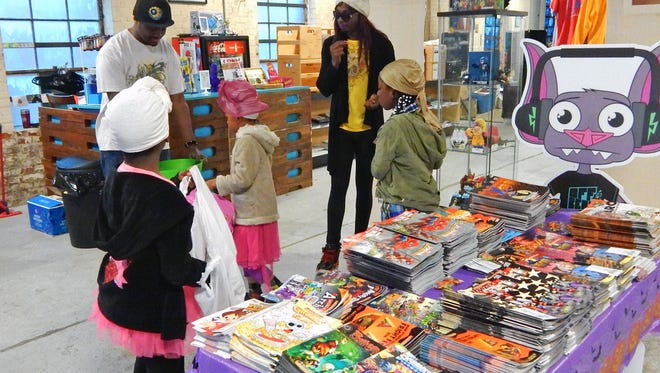 Offbeat in Jackson drew kids of all ages to its second annual Halloween Comicfest on Saturday. Giveaways and activities offered a Halloween option to several families, especially given the heavy rain. Off Beat in Jackson held its second annual Halloween ComicFest Saturday. Kids of all ages came dressed in their favorite costumes and came to take advantage of the Comic Book giveaway as well as various other activities.