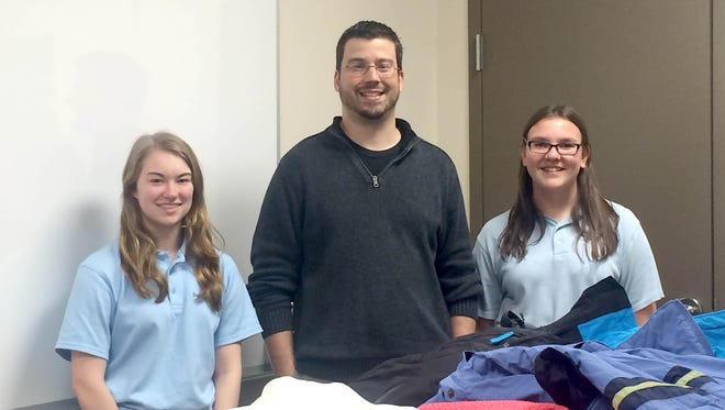 Pictured, from left, are: Corrine Beil; Gary Hatez, freshman class moderator; and Peyton Golowski.