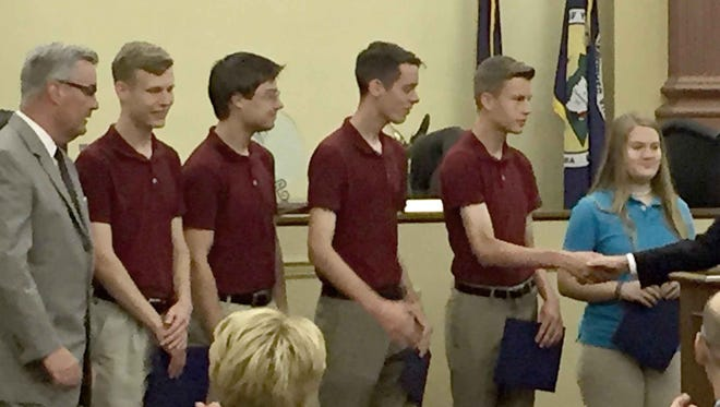 The York Home Schoolers, one of the York County Senior High Envirothon teams, were recognized at Wednesday's county commissioners' meeting for their fifth place win in the 2016 state Envirothon. The team competed against 64 other teams recently at Susquehanna University. Team members, standing next to Commissioner Chris Reilly, are, from left to right, team captain Jonathan Rothermel, Jonathan Schmidt, Jonathan McGee, Daniel Rothermel and Emma Cramer. Not pictured is team member Sarah Smith.