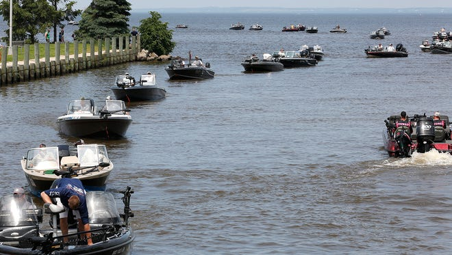 Fishermen come in from Lake Winnebago Saturday to have their walleye weighed during Walleye Weekend in Fond du Lac in Lakeside Park.