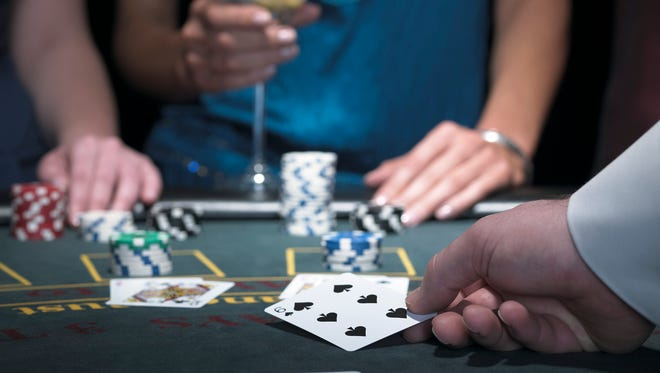 What do blackjack dealers have to hit on the market