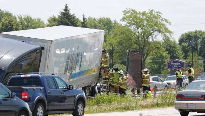 Firefighters work at the crash scene Tuesday on Interstate 41 in Fond du Lac.