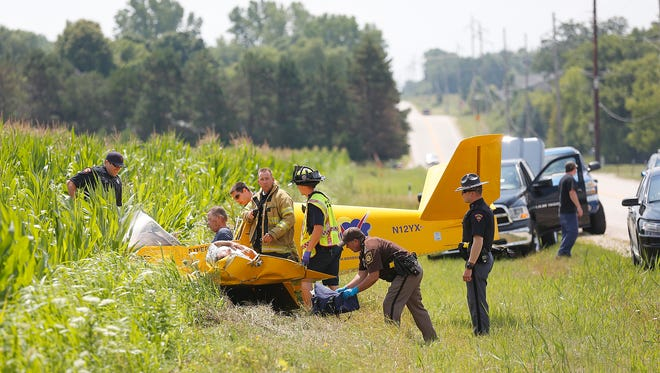 A plane owned by SONEX Aircraft LLC in Oshkosh crashed Wednesday along Esterbrook Road in Fond du Lac when a wing caught a guide wire of an electrical power line, spinning the plane backward and almost instantly dropping it about 40 feet to the ground. Two people in the plane were injured.