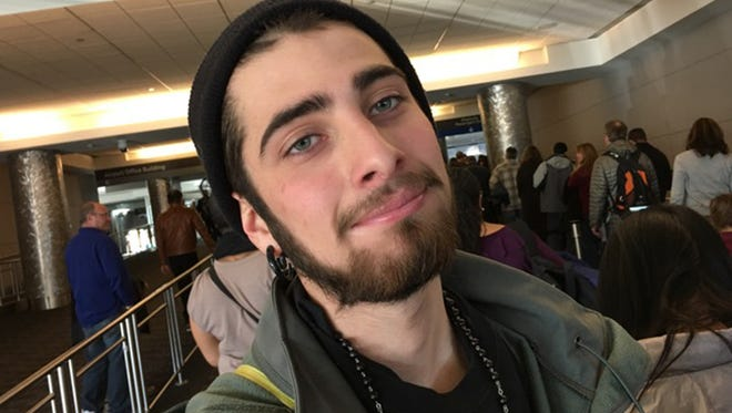 In this Jan. 10, 2016, family photo made available Wednesday, Aug. 10, 2016, Jordan MacTaggart is shown in a photograph made by his father Robert at Denver International Airport in Denver.