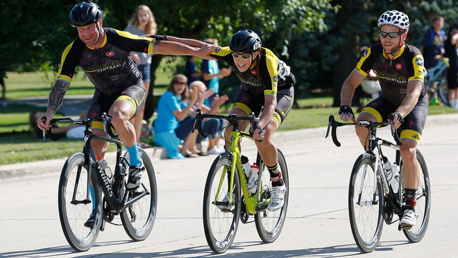 Andy Feuersthaler, Laure Fisher and Eric Brandt of Milwaukee finish the 90-mile Race the Lake bicycle race in Lakeside Park Sunday.