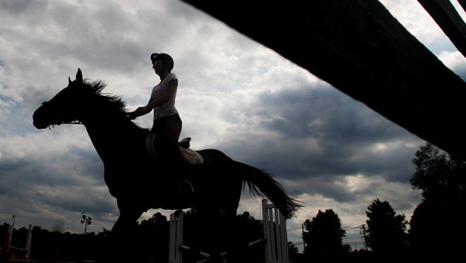 A horse and rider are seen in this 2015 file photo taken at Seaton Hackney stables in Morris Township. A horse at a different but undisclosed location in Morris County was euthanized on Aug. 13, 2016, after contracting eastern equine encephalitis, according to the state Department of Agriculture.
