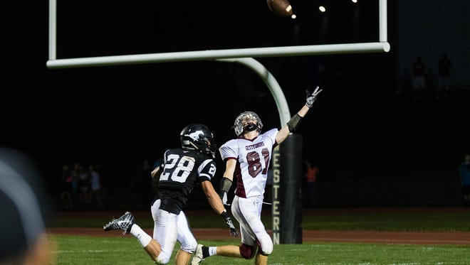 Gettysburg's Brady Fouchie (81) attempts to make a catch while pursued by South Western's Drew Hartlaub (28) during the season opener at South Western High School on Friday, Sept. 2, 2016.