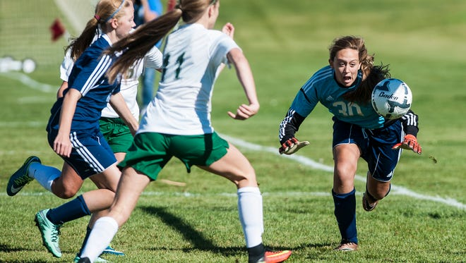 Great Falls' Jorgie Hawthorne dives to block during the girls' Crosstown soccer game at Siebel Soccer Complex Thursday.