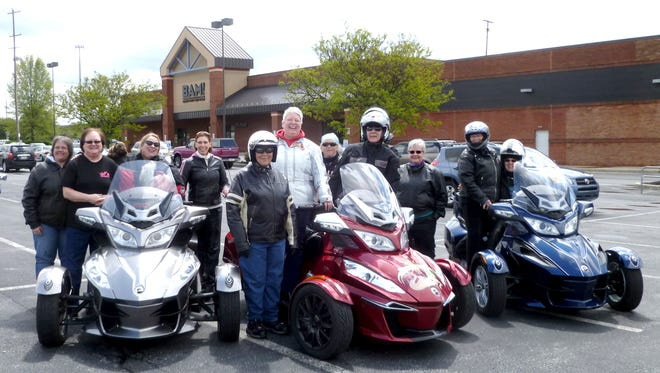 Members of the Twin Rose Lady Riders pose with some of the three-wheelers in the club. Shown here are: Dawn Sherlock, Elaine Holland, Lynn Martin (chapter president), Kathy Hoffer, Anna Martin, Susan Rozer, Natalie Winegarden, Susan Spittle, Bernie Becker, Sigi Schmidt, and Nancy Cheris.