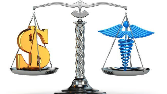 Caduceus and dollar signs on scales.