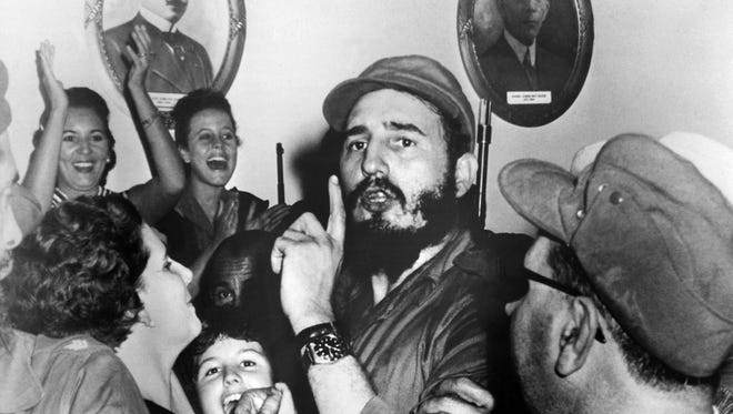 Picture of Cuban leader Fidel Castro, center, shortly after toppling dictator Fulgencio Batista, during the revolutionary triumph, in Cienfuegos, Cuba, on Jan. 4, 1959. Castro died Friday, Nov. 25, 2016, at the age of 90.