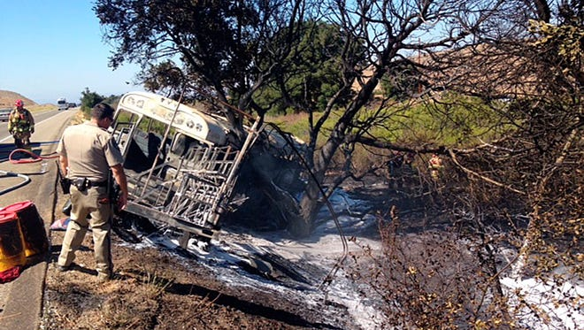 This Aug. 11, 2016 photo provided by the Santa Barbara County Fire Department shows a converted school bus carrying more than two dozen farmworkers which crashed in a rural part of Santa Barbara County and burst into flames, fire officials said. Six people were injured and taken to a hospital, according to Capt. Dave Zaniboni of the Santa Barbara County Fire Department.