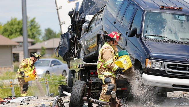 City of Fond du Lac fire personnel work the scene of a fatal crash on Interstate 41 near Johnson Street July 5, 2016. A flatbed truck carrying two vehicles rear-ended a semitrailer.