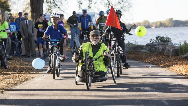 Floyd Freiberg leads a group of bikers, rollar bladers and walkers after a ceremony to reveal the new segment of the Fond du Lac Loop in Lakeside Park October 2016. Construction to build this segment along the lakefront started mid-September and is part of future plans to make Lakeside Park a modern destination for both locals and visitors.