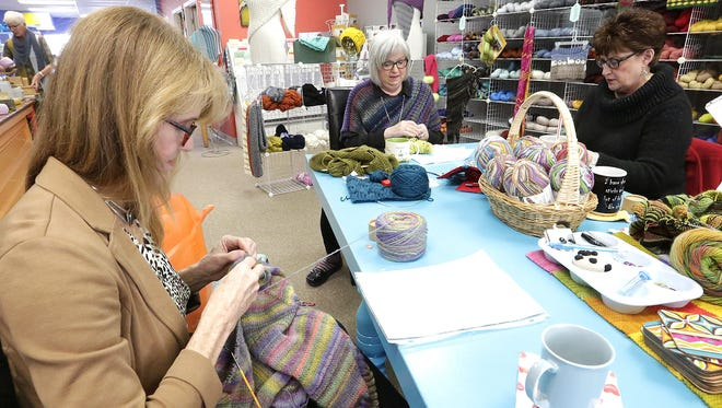 Eileen Kennedy, Sandie Berka and Yvonne Baker socialize while knitting on a Wednesday morning at The Knitting Room in downtown Fond du Lac.