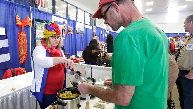 Nora Dee plates up traditional Cuban food during United For Diversity's 10th Celebrate CommUNITY event, held at the Fond du Lac County Fairgrounds Saturday Feb. 18. The festival brings many cultures and religions together in hopes of creating a greater acceptance of all.