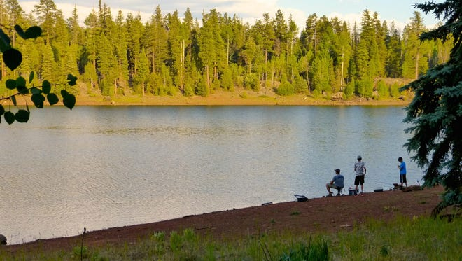 A father and his sons try their luck at A-1 Lake on the White Mountain Apache Reservation.