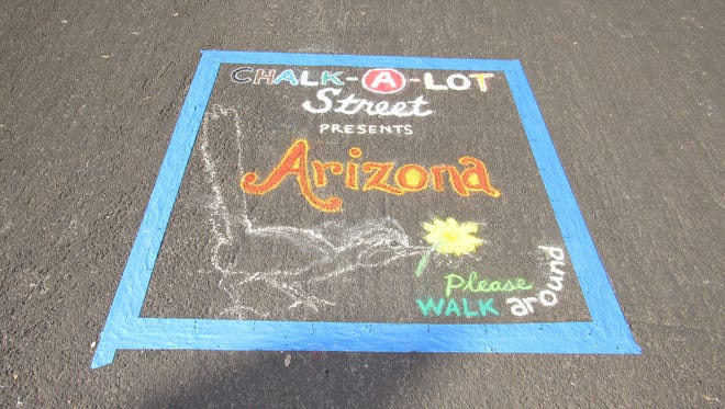 At the Tempe Festival of the Arts, professional and student artists create intricate chalk art murals.