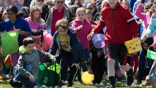 Kids in the 9-10 age group run to collect eggs at the ninth annual Hanover Community Easter Egg Hunt held at Moul Field in 2016.