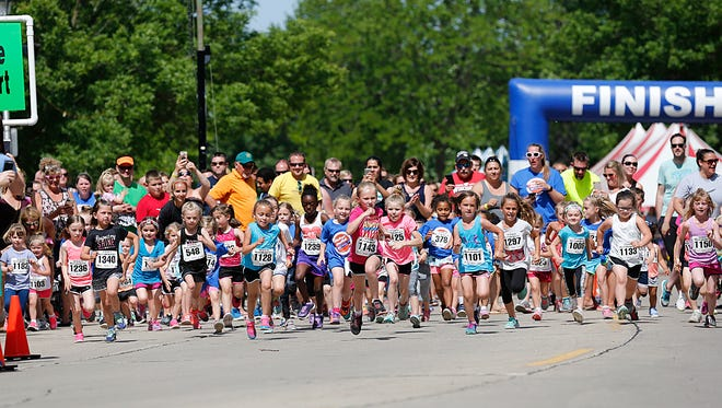 Kids run in Fond du Lac's 2017 The Reporter Walleye Run/Walk 1/3-mile Rookie Run Saturday June 10, 2017 in Lakeside Park. The festival took place on June 9, 10 and 11. Doug Raflik/USA TODAY NETWORK-Wisconsin