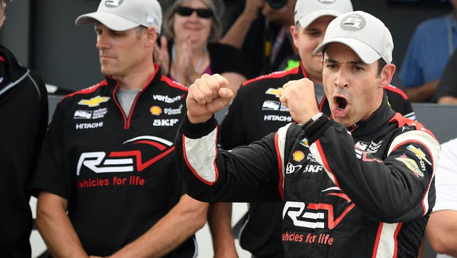 Helio Castroneves reacts after winning the pole during qualifying for the Kohler Grand Prix at Road America.