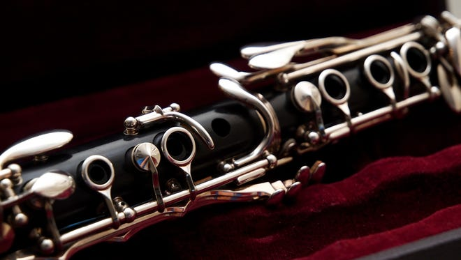 Close up of a clarinet resting on its case.