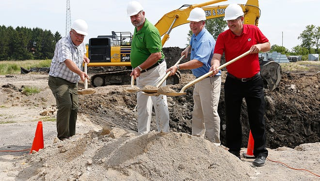 A ground breaking ceremony for a new feed mill takes place Wednesday July 19, 2017 on the site of the exhisting Brandon feed mill. From left to right are Dick Vollbrecht, Perry Goetsch, Kieth Ripp and Steve Hellenbrand. Doug Raflik/USA TODAY NETWORK-Wisconsin