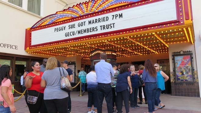 "Fans line up to watch the film ""Peggy Sue Got Married "" starring Kathleen Turner Friday night at the Plaza Theatre."