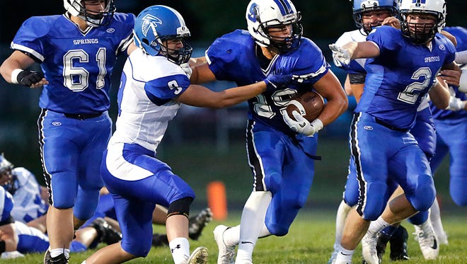 St. Mary's Springs High School football's Clay Schueffner runs the ball against Amherst Friday August 25, 2017 at Fruth Field in Fond du Lac. Doug Raflik/USA TODAY NETWORK-Wisconsin