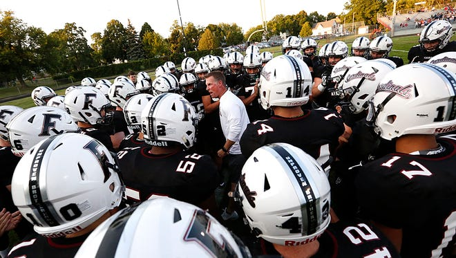 Fond du Lac High School football's head coach Mike Gnewuch gets his team fired up for their game against Appleton North on Sept. 1, 2017 at Fruth Field.