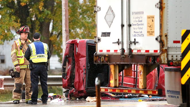 Emergency responders work the scene of a four vehicle crash with nine injuries Sunday, near the intersection of State 23 and Whispering Springs Drive, east of Fond du Lac.
