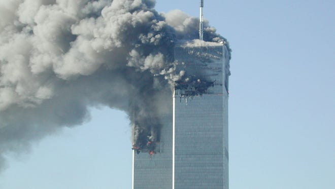 Smoke pours from the World Trade Center after being hit by two planes on Sept. 11, 2001 in New York City.
